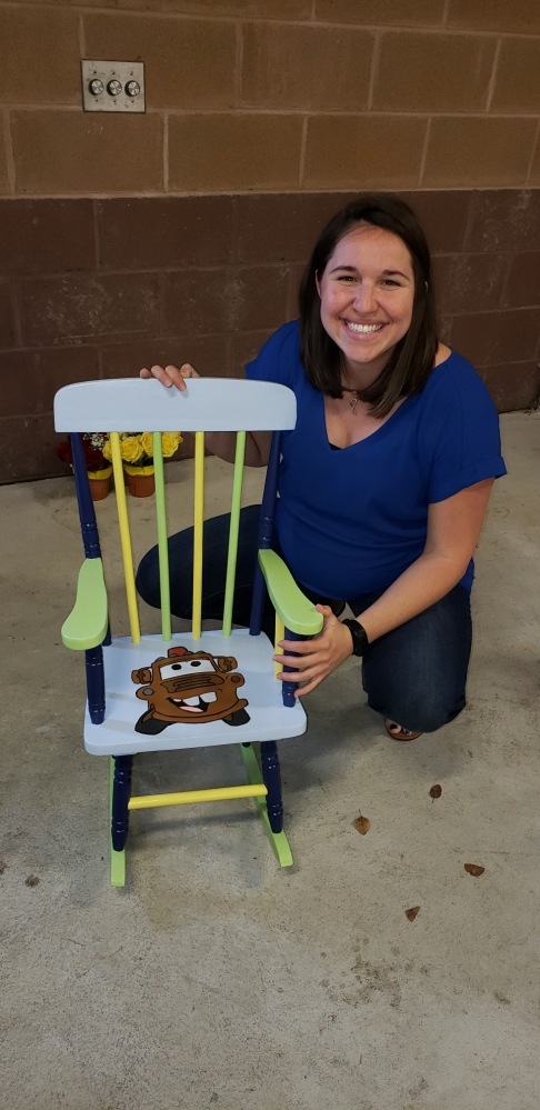 julie with mater chair.JPG