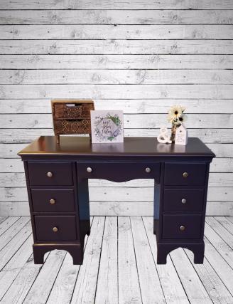 purple desk with backdrop